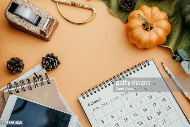 flat lay desktop with october calendar - october stock pictures, royalty-free photos & images
