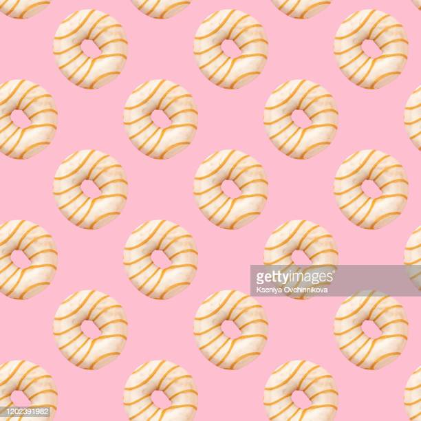 flat lay donuts pattern on a yellow background. top view - 木曜日 ストックフォトと画像