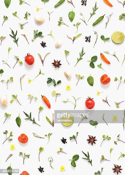 Flat lay fresh vegetables, herbs and spices on white background.
