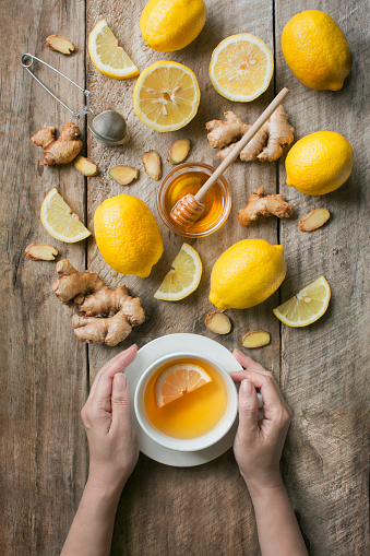 Flat lay honey lemon ginger tea. - gettyimageskorea