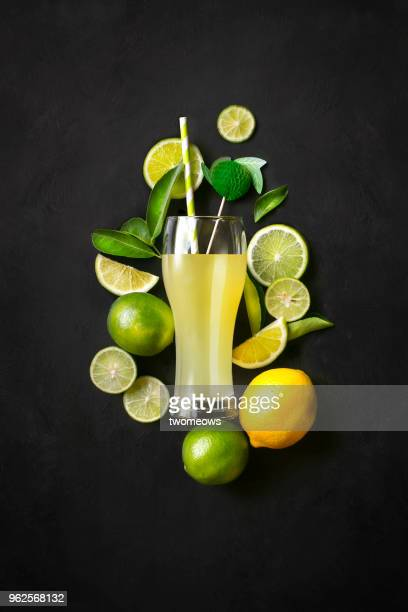 flat lay lemon lime juice. - composition stock pictures, royalty-free photos & images