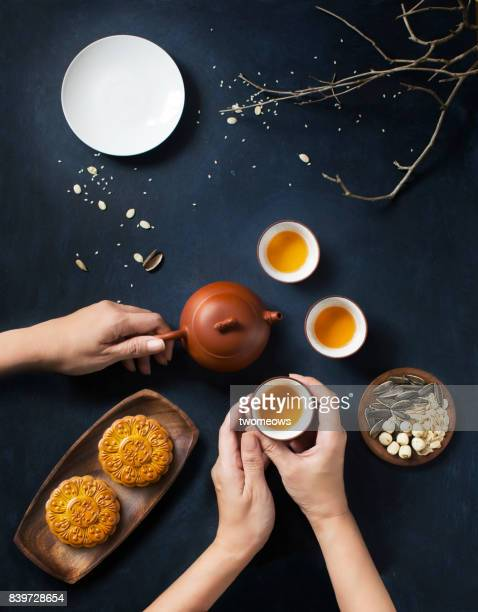 flat lay mid autumn festival tea time, food and drink table top shot. - moon cake stock pictures, royalty-free photos & images