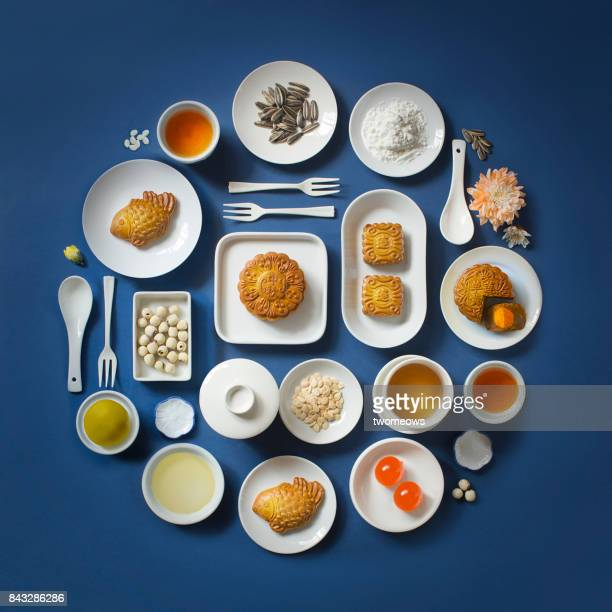 flat lay mid-autumn festival food and drink still life. - moon cake stock pictures, royalty-free photos & images