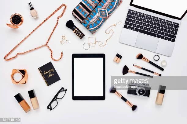 flat lay of beauty products and accessoroes on bloggers desk - pochette borsetta foto e immagini stock