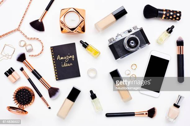 flat lay of beauty products on bloggers desk - manufactured object stock pictures, royalty-free photos & images