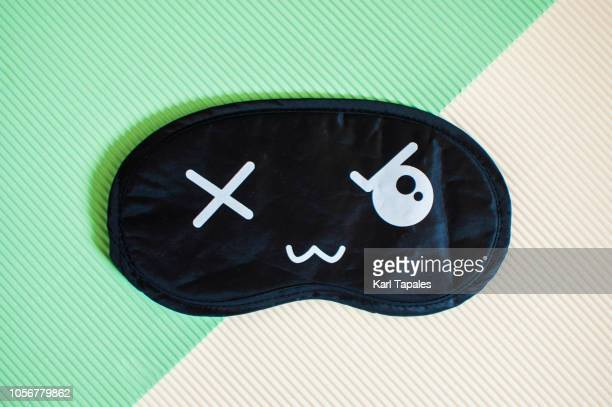 flat lay of black and white sleep mask - black mask disguise stock pictures, royalty-free photos & images