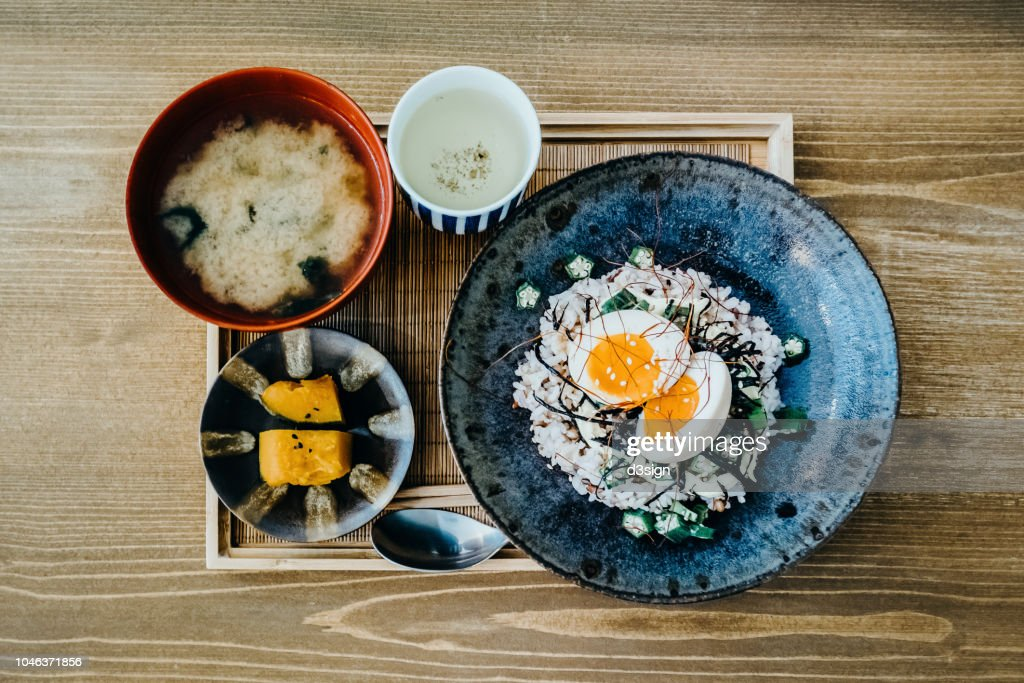 Flat lay of delicate Japanese meal with appetizer, miso soup and tea freshly served on table in a restaurant : Stock Photo