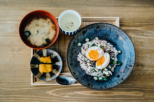 Flat lay of delicate Japanese meal with appetizer, miso soup and tea freshly served on table in a restaurant - gettyimageskorea