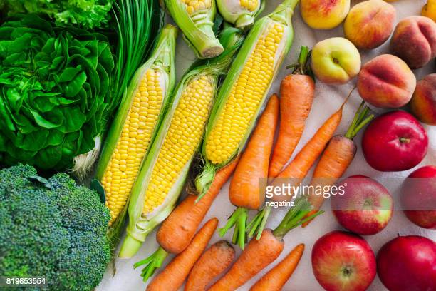 flat lay of different summer fruits, vegetables, greens and berries - colors of rainbow in order stock pictures, royalty-free photos & images