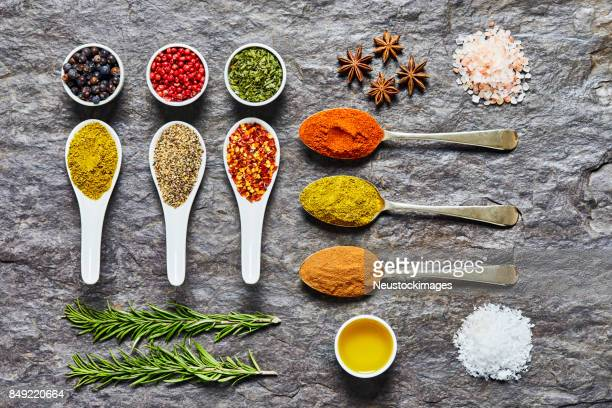 flat lay of indian herbs and spices on slate background - garam masala stock photos and pictures