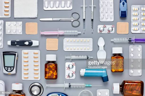 Flat lay of medical supplies arranged on gray background