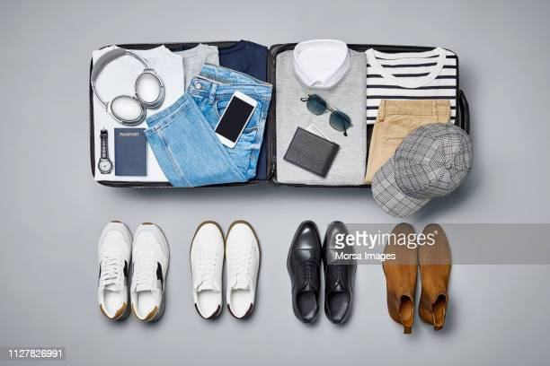 flat lay of menswear and personal accessories - silver shoe stock pictures, royalty-free photos & images