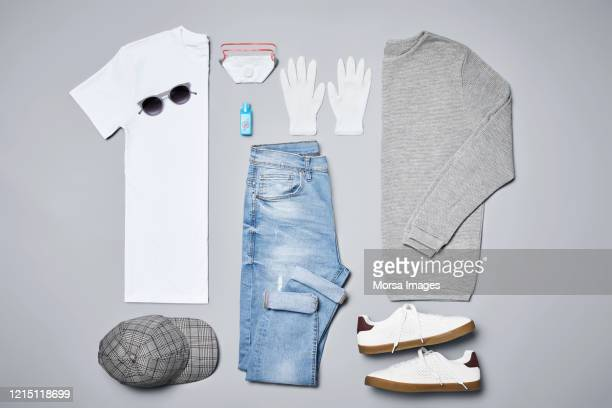 flat lay of menswear with personal accessories against covid-19. - panic buying stock pictures, royalty-free photos & images