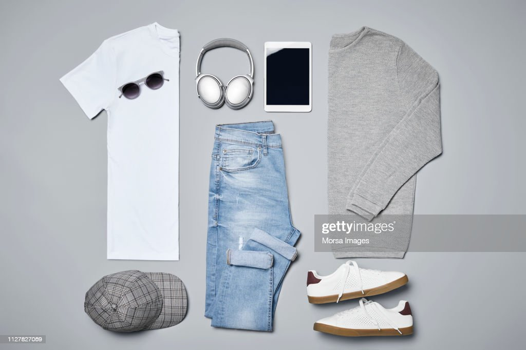 Flat lay of menswear with personal accessories : Stock Photo