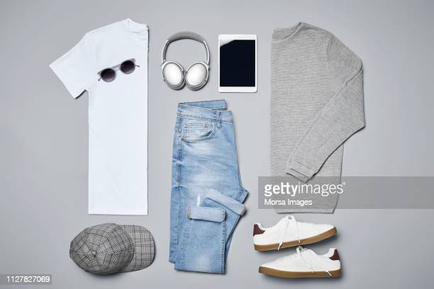 Flat lay of menswear with personal accessories