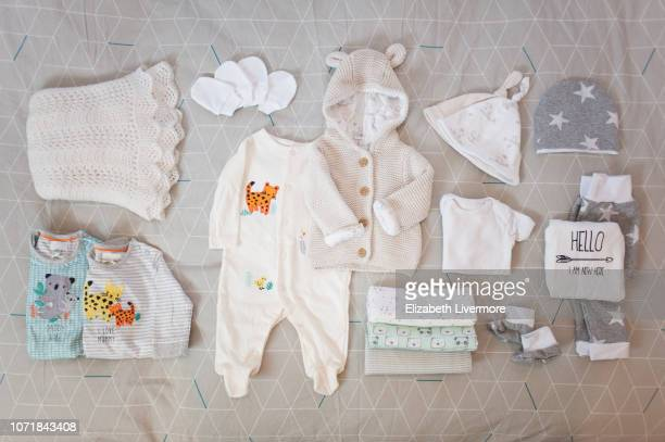 Flat lay of newborn baby clothing