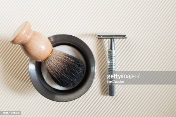 flat lay of shaving accessories - shaving brush stock photos and pictures