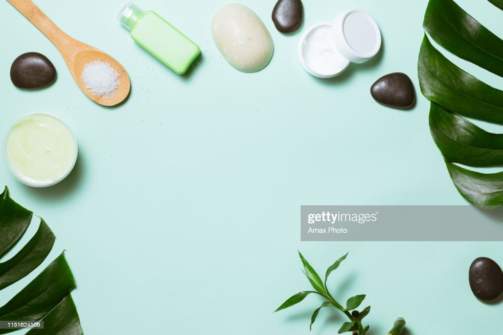 Flat lay of spa cosmetic with bamboo, salt for bath, cream and towel on pastel background, top view mock-up : Stock Photo