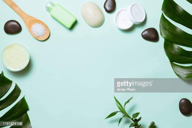 flat lay of spa cosmetic with bamboo, salt for bath, cream and towel on pastel background, top view mock-up - flat lay stock pictures, royalty-free photos & images