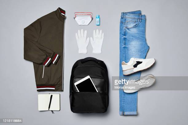 flat lay of traveler's clothes and accessories against covid-19. - panic buying stock pictures, royalty-free photos & images