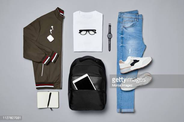 flat lay of traveler's clothes and accessories - fashion collection stock pictures, royalty-free photos & images