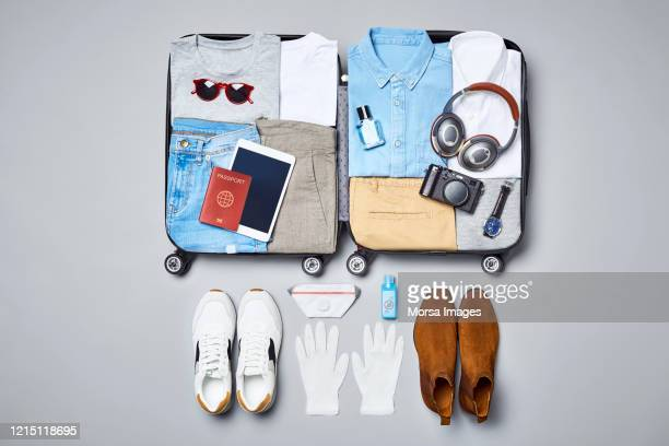 flat lay of traveler's clothing and accessories - travel ストックフォトと画像