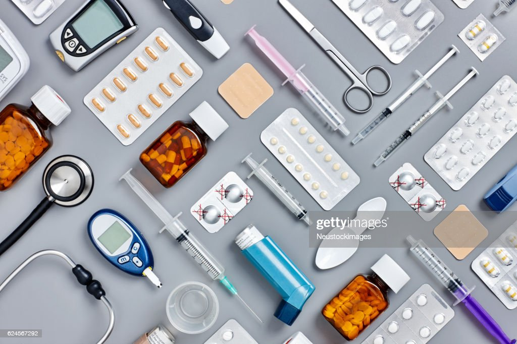 Flat lay of various medical supplies on gray background : ストックフォト