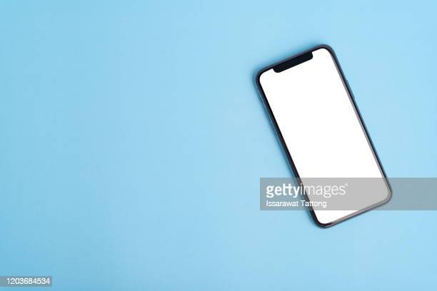 flat lay on blue workspace with cell phone gadget, .blue textured office desk. deadline concept. copy space, background, top view. - template stock pictures, royalty-free photos & images
