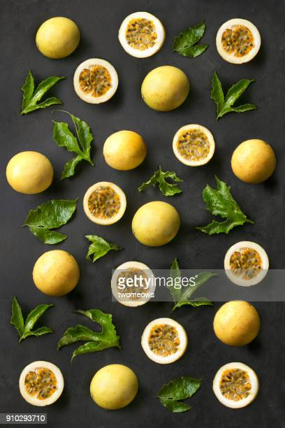 flat lay passion fruits pattern on textured back background. - パッションフルーツ ストックフォトと画像