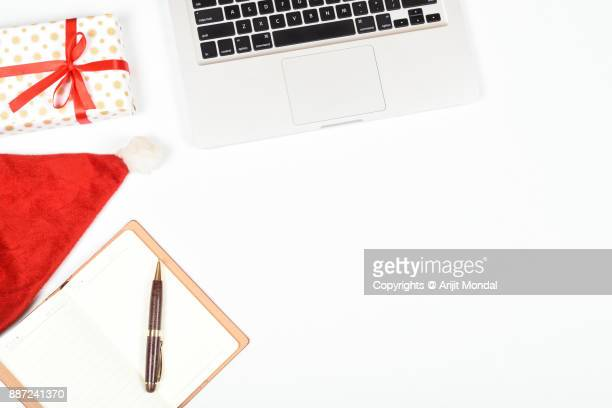 Flat lay scene with office table desk  with laptop and Christmas decorations on white background