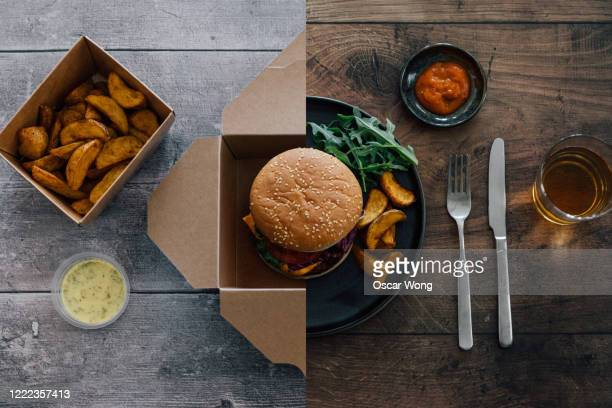flat lay shot of burger - half in takeaway box, half on plate - gourmet stock pictures, royalty-free photos & images