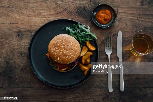 flat lay shot of burger on dining table - elevated view stock pictures, royalty-free photos & images