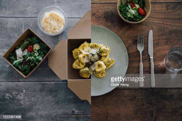 flat lay shot of pasta - half in takeaway box, half on plate - food stock pictures, royalty-free photos & images