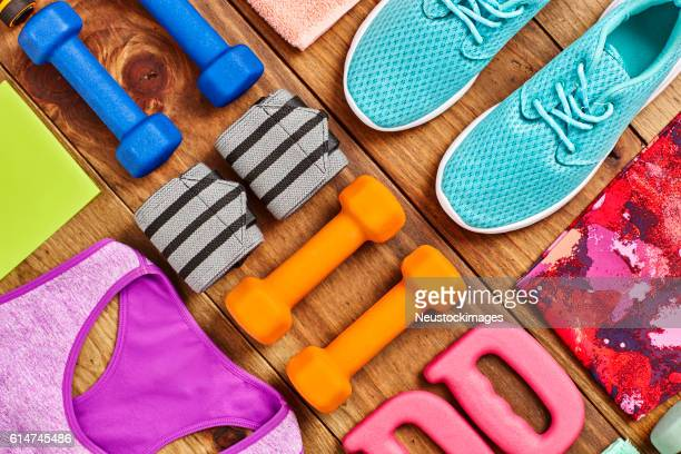 flat lay - sports equipment arranged on hardwood floor - sportswear stock pictures, royalty-free photos & images