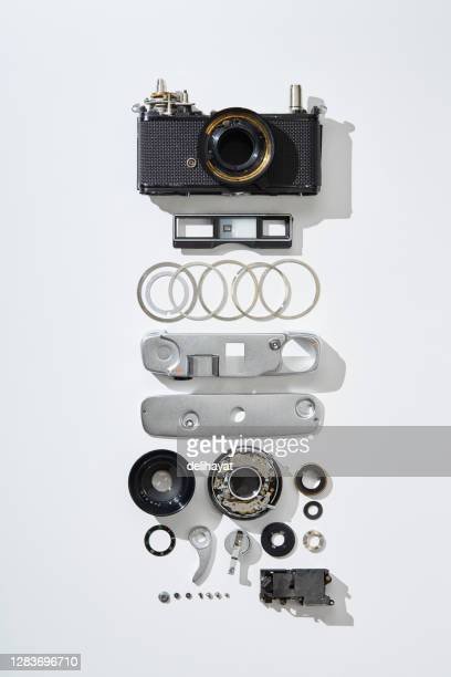 flat lay top view of parts and components of a disassembled vintage film camera - dismantling stock pictures, royalty-free photos & images