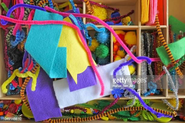 flat lay view of pieces of art and craft box - rafael ben ari stockfoto's en -beelden