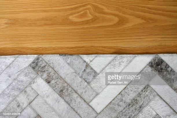 Flat Lay View of Wooden Floor and a Carpet