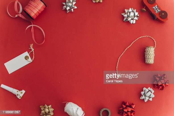 flat lay xmas items frame in red - flat lay stock pictures, royalty-free photos & images