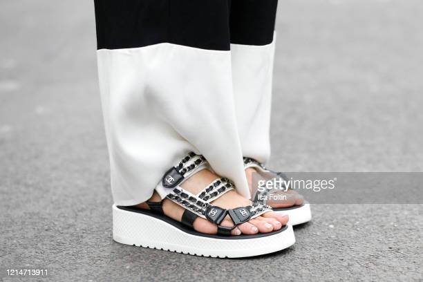 Flat sandals by Chanel as a detail of influencer Gitta Banko during a street style shooting on March 19, 2020 in Duesseldorf, Germany.