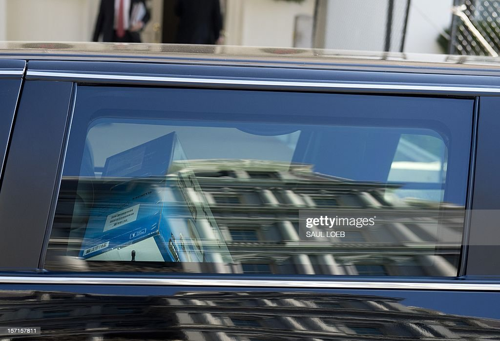 A flat screen television purchased by US Vice President Joe Biden appears in the back of a limousine after Biden arrived at the White House following a shopping trip to a Costco store in Washington, DC, on November 29, 2012. Biden made the visit to the first Costco store located in Washington, DC, during its grand opening. AFP PHOTO / Saul LOEB