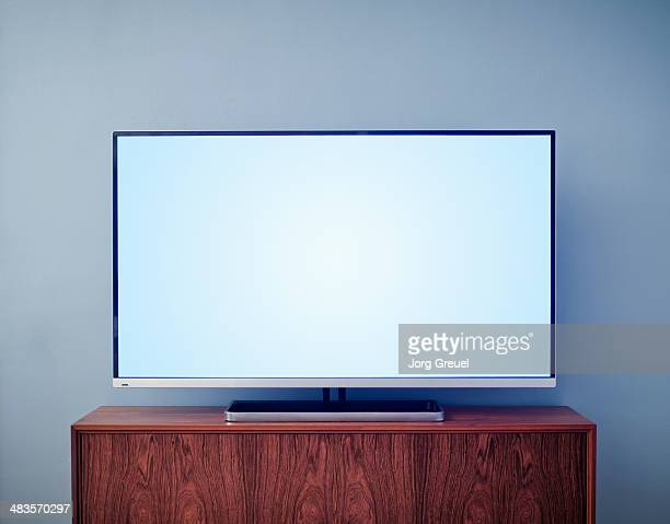 flat screen tv on cabinet - flat screen stock pictures, royalty-free photos & images