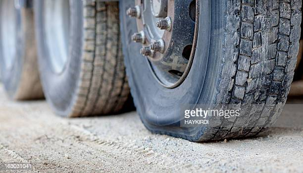 flat tire on a semi trailer - flat tire stock pictures, royalty-free photos & images