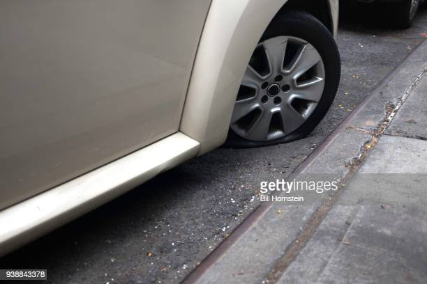 flat tire - curb stock pictures, royalty-free photos & images