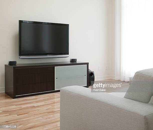 flat wide screen tv in home living room - flat screen stock pictures, royalty-free photos & images