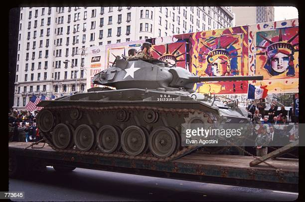A flatbed carries a tank down a street during 'The Nation's Parade' November 10 1995 in New York City 'The Nation's Parade' is a tribute to the eight...