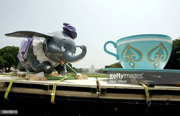 A flatbed truck carrying Dumbo The Flying Elephant and a tea cup from Mad Hatter's Tea Party gets a police escort near the capitol June 6 2005 in...