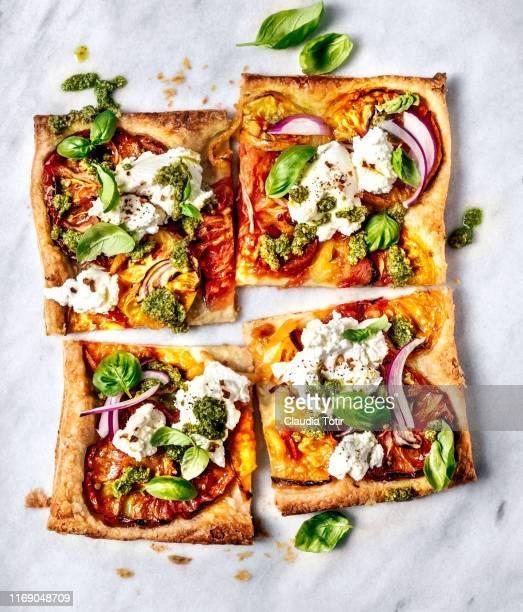 flatbread pizza on white background - scheibe portion stock-fotos und bilder
