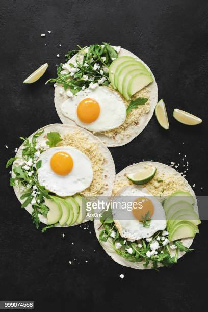 flatbread with avocado, egg and green salad - tortilla flatbread stock pictures, royalty-free photos & images