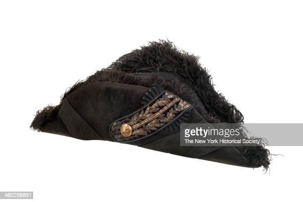 Flatfolding black beaver chapeau with black ostrich feather trim on edges of cock and fan 1870 Two bands of wide black ribbon extend diagonally from...