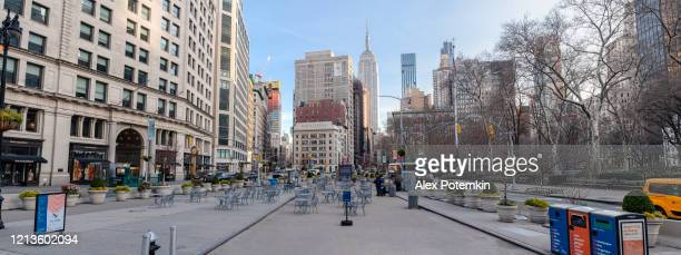flatiron public plaza deserted during the coronavirus outbreak - alex potemkin coronavirus stock pictures, royalty-free photos & images